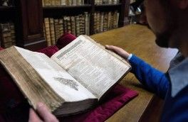 "Remy Cordonnier, librarian in the northern town of Saint-Omer, near Calais carefully shows an example of a valuable Shakespeare ""First Folio"", a collection of some of his plays, dating from 1623. Around 230 copies of the First Folio are known to exist in collections or in private hands around the world"